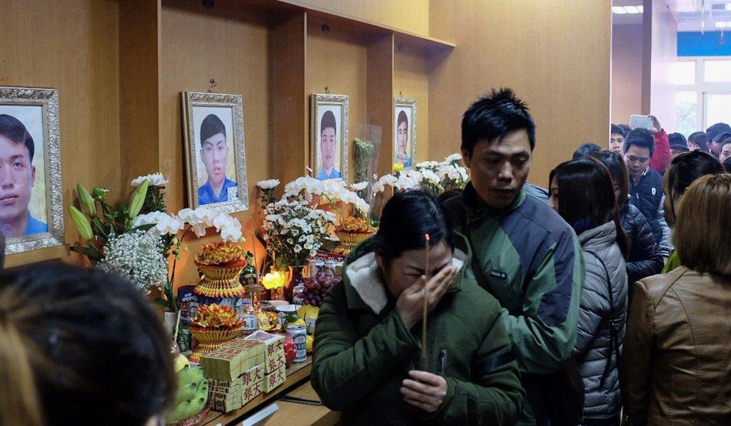 Tang lễ của 6 công nhân tử nạn trong đám cháy năm 2017. Ảnh: SCMP
