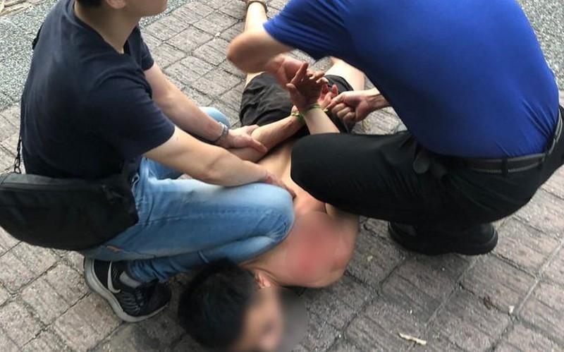Nghi phạm người Việt bị bắt giữ. Ảnh: CNA